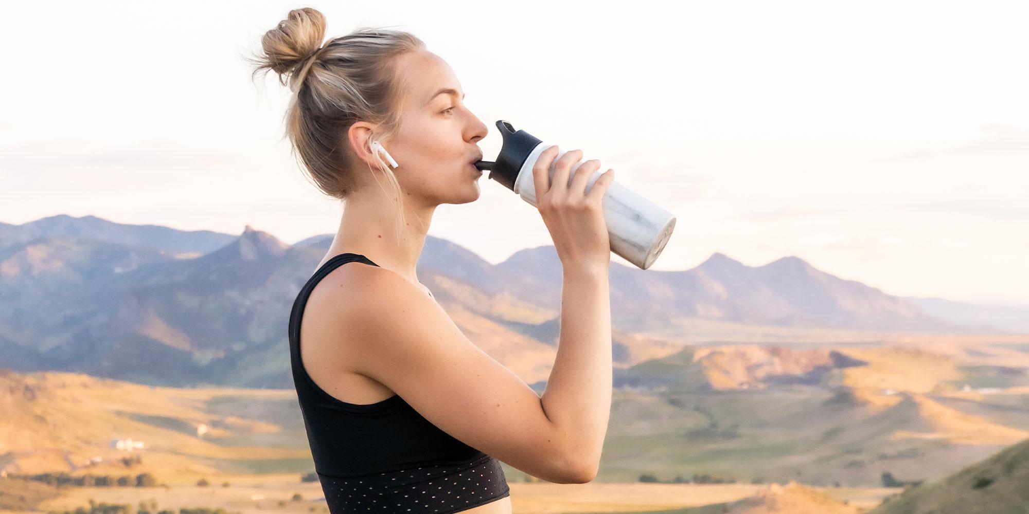 woman drinking redmond re-lyte